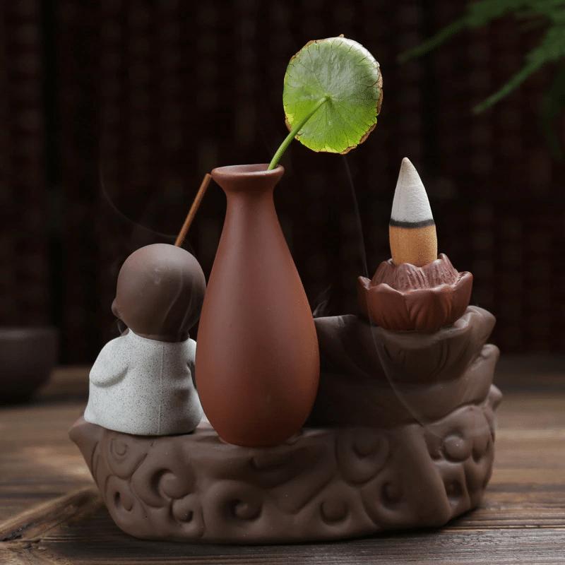 Porte encens à refoulement Bouddha Zen https://www.chakras-shop.com